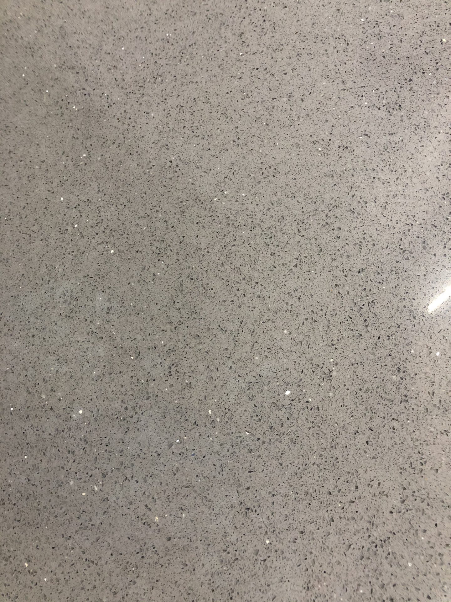grey sparkle countertop by Magnolia Countertops. A Countertop fabricator of Granite Countertops, Marble Countertops, and Quartz Countertops in Cookeville and Crossville TN.